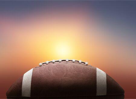 Balón de fútbol americano en el fondo Foto de archivo