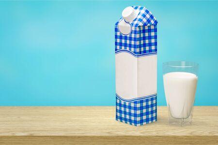 Milk in glass and box on wooden Zdjęcie Seryjne