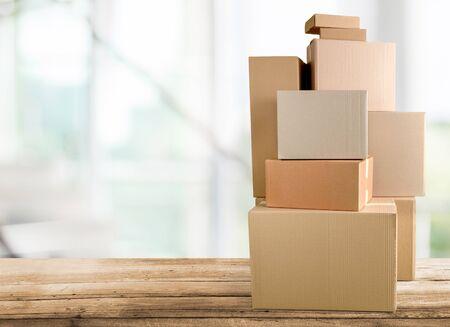 Different cardboard boxes in room on wooden Standard-Bild - 131983897