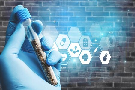 Science Technology and Cannabis in hand