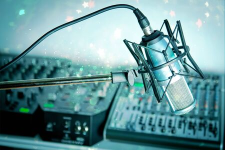 Microphone in digital studio on background 免版税图像