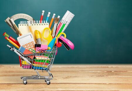 Stationery objects in mini supermarket cart 免版税图像