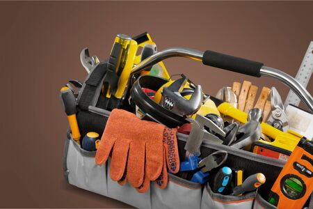 Tool belt with tools on wooden background Archivio Fotografico - 129155323