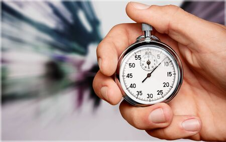 Stopwatch in Human Hand, close-up view