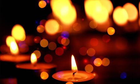 Close up view of the candles cutting through the darkness. Stock fotó