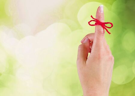 Rope bow on finger pointing  up on background