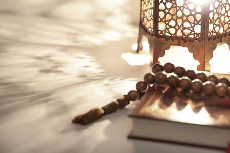 Ornamental Arabic lantern with burning candle glowing