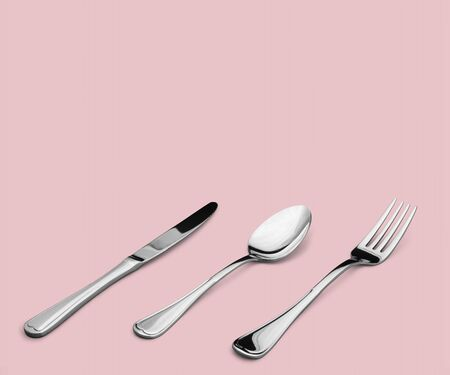 Fork, spoon and knife on blue background