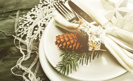 Festive table setting with cone for Christmas