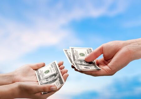 Two hands holding dollars banknote