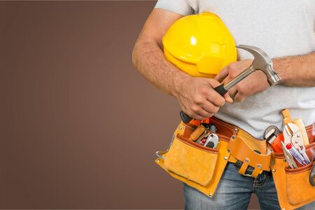 Worker with a tool belt. Isolated over  background. Archivio Fotografico - 129160938