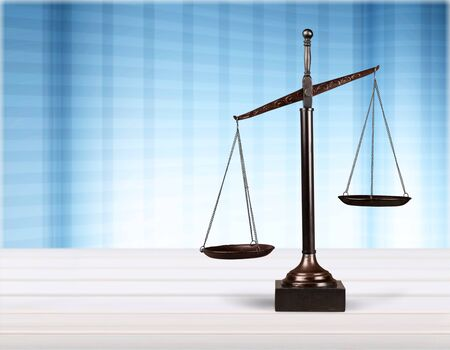 Law scales on wooden table