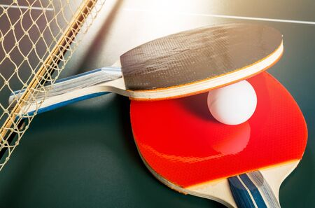 Table Tennis Rackets and Ball on Table