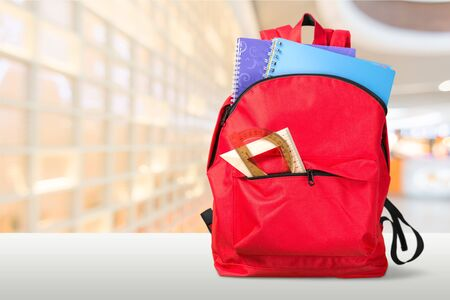 Colorful school supplies in backpack on blurred Stock fotó