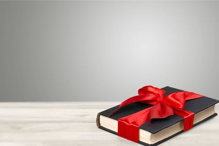 Holy Bible book in red ribbon