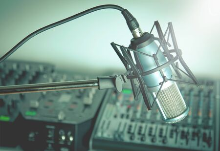 Microphone and digital studio mixer on background