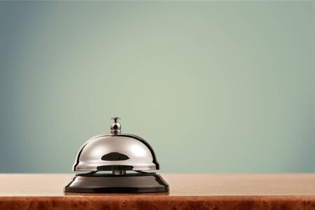 Vintage hotel reception service desk bell Фото со стока