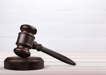 Wooden gavel on wooden table