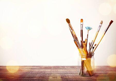 Brushes in a glass jar Standard-Bild