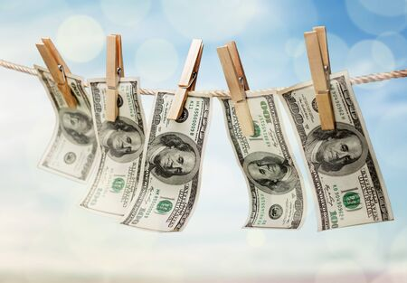 American dollars in a rope on background