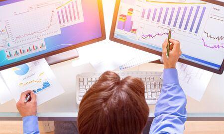 Portrait of a Businessman Analyzing Charts Stock Photo