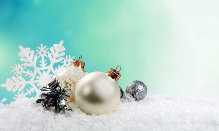 Silver christmas balls over snow background