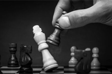 Businessman Hand Holding a Chess Piece