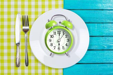 Intermittent fasting concept above breakfast clock delay