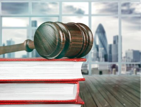 Books and wooden gavel on table. Justice concept