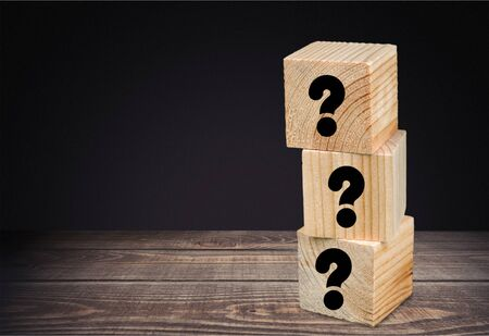 Three wooden cubes with question marks Zdjęcie Seryjne
