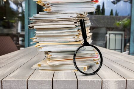 Stack of Documents  Files with Magnifying Glass Stock fotó
