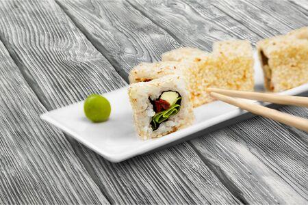 Sushi rolls japanese food on desk