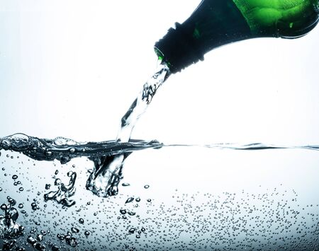 Water Pouring out of Plastic Bottle on the Grey background