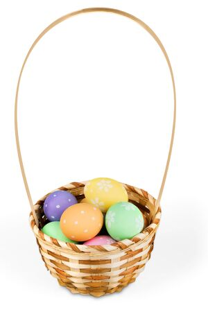 Basket with colorful eggs isolated on white background 免版税图像