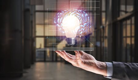 Human holding tablet with light bulb future technology, brain and network connection communication background, science, innovation and creative idea concept