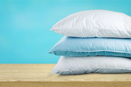 Soft Pillows Pile on grey background, three Imagens
