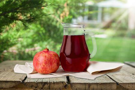 Fresh pomegranate on woden desk