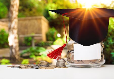 Coins money in bottle and graduation cap