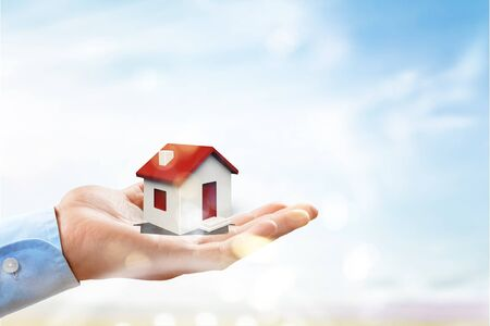 hands holding house. Real estate and property Stock Photo