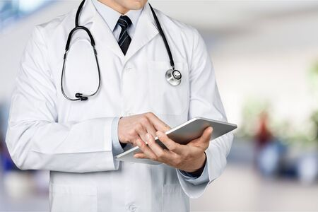 Close-up Doctor at hospital working with tablet Stock Photo