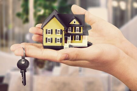 Businessman Holding House Model and Keys, Real Stock fotó