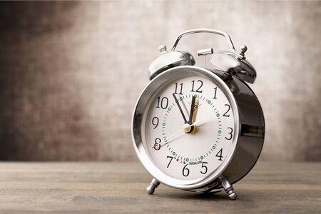 Vintage retro alarm clock on table