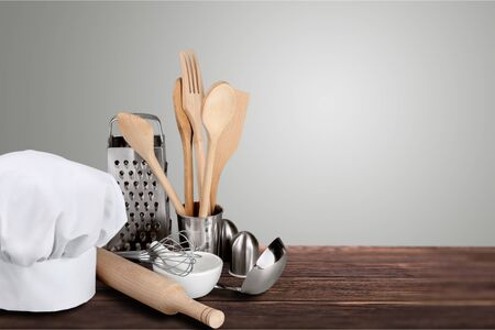 Set of kitchen utensils on wooden table Фото со стока