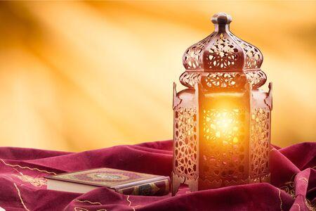 Ornamental silver Moroccan, Arabic lantern on white linen throw.