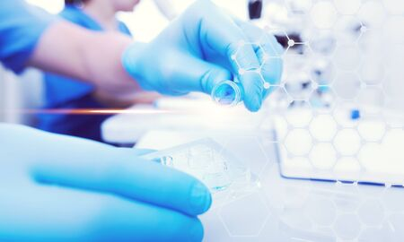 Woman scientist take test tube in the laboratory 版權商用圖片