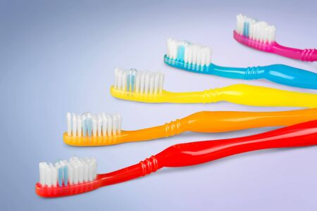 Colorful toothbrush rainbow on grey Stock Photo