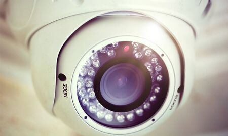 Security Camera on the Ceiling in Office Building Imagens