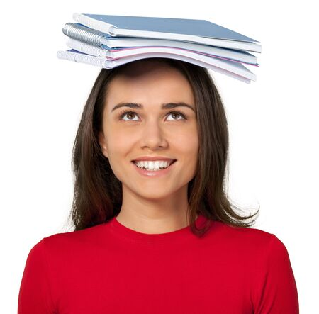 Girl with notebooks on her head isolated on white