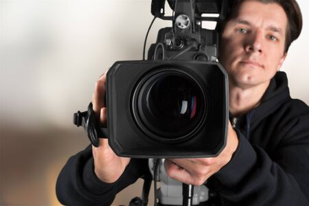 Cameraman with his camera on blurred Imagens
