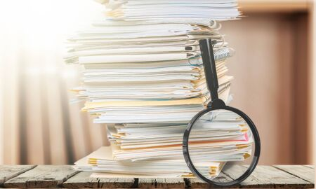 Stack of Documents  Files with Magnifying Glass on wooden table Stok Fotoğraf